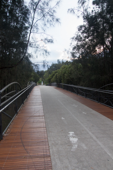 Across this bridge was the picnic area, the basketball ring and then the exit to the park.